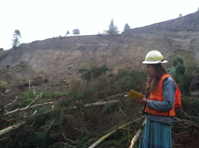 Hazards geologist, Isabelle Sarikhan, works at the site of the March 27 Whidbey Island landslide event.