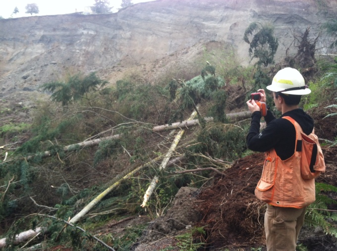 Hazards geologist, Stephen Slaughter, surveys the Whidbey Island landslide site.