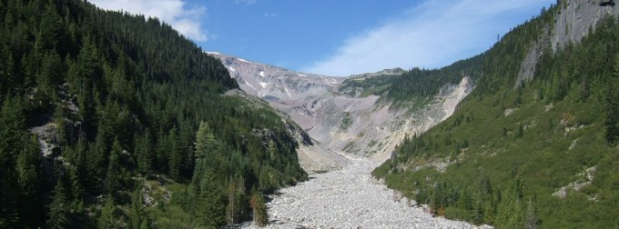 Picture of the Nisqually River and Glacier taken from the Nisqually River Bridge in Mount Rainier National Park (2007). Image courtesy of Dave Norman (DNR).