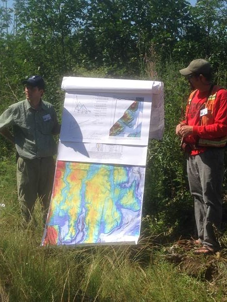 Michael and Trevor providing an overview of Center and Quilcene geology at an outcrop of Lyre Formation conglomerate. Photo courtesy of Michael Machette (Jefferson Land Trust).