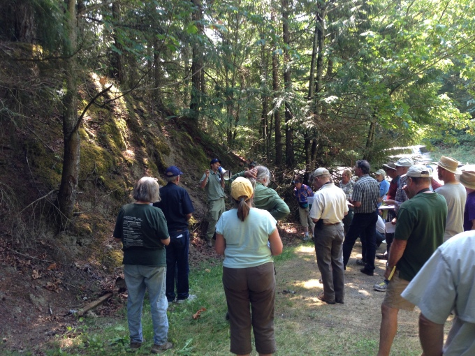 Michael Polenz discussing Lyre Formation mudstone along State Route 104 near Center Rd. Photo courtesy of Ian Hubert (DNR).